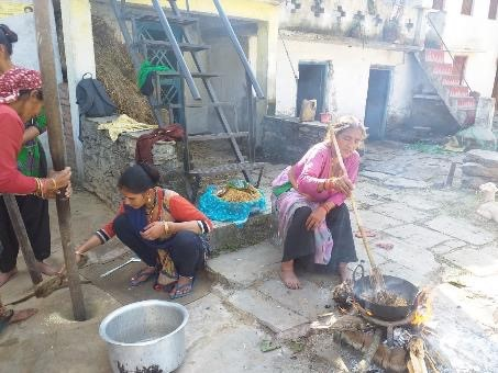 Women preparing Chyuda, a rice dish with nuts and seeds, distributed amongst neighbours and relatives on Diwali (festival of lights).