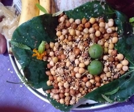 An offering (Prasad) to a local deity, made from local pulses, grains, millets and fruits.
