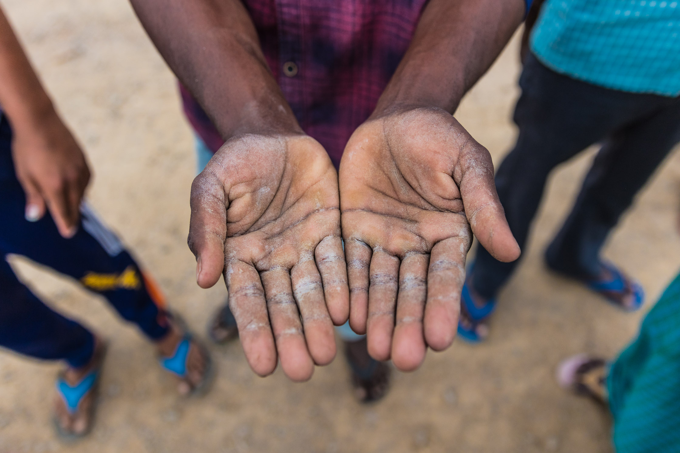 The hands of a stonecutter from Warangal, Telangana. Photo credit: Toby Smith.